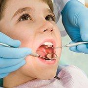 Удаление зуба ребенку